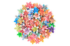Paper flowers. A circle pile of colourful paper flowers on a white background royalty free stock photo