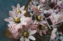 Paper flowers decoration. Tabletop decorations with paper flowers and chocolate candies stock photography