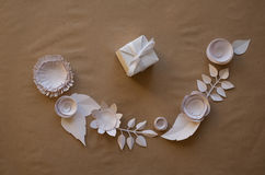 Paper flowers and gift. Small paper flowers and leaves  and  gift, white csrd Stock Photos