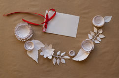 Paper flowers and gift. Small paper flowers and leaves  and  gift, white csrd Royalty Free Stock Photography