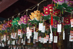 Paper flowers and good wishes cards at Chinese temple Royalty Free Stock Photo