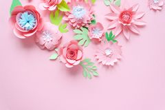 Pink paper flowers on the pink background royalty free stock photography