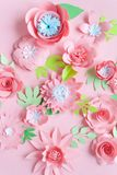 Pink paper flowers on the pink background stock photography