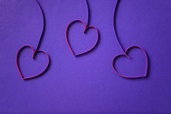 Paper flowers with hearts on purple background Royalty Free Stock Image