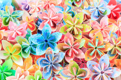 Paper flowers. A pile of colourful Japanese Kusudama flower pieces Royalty Free Stock Photo