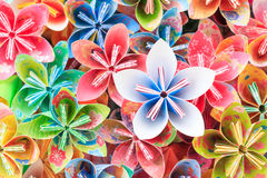 Paper flowers. A pile of colourful Japanese Kusudama flower pieces. Shallow depth of field. Focus on the blue/pink flower on top of the pile Royalty Free Stock Photo