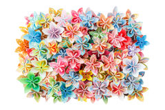 Paper flowers. A rectangle pile of colourful paper flowers isolated on a white background Royalty Free Stock Photography