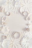 Paper flowers. Round frame with white paper flowers on white background. Cut from paper Royalty Free Stock Images