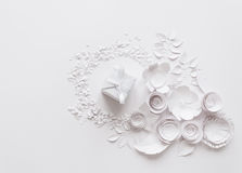 Paper flowers on the white background. Paper flowers and white gift on the white background Royalty Free Stock Photography