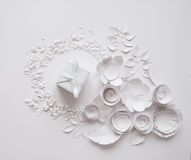 Paper flowers on the white background. Paper flowers and white gift on the white background Royalty Free Stock Photos