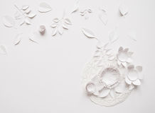 Paper flowers on the white background. Paper flowers and white gift on the white background Royalty Free Stock Photo