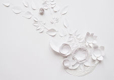 Paper flowers on the white background. Small paper flowers and leaves on the white background Stock Photos