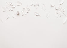 Paper flowers on the white background. Small paper flowers and leaves on the white background Royalty Free Stock Images