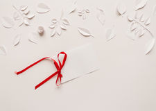 Paper flowers on the white background. Small paper flowers and leaves on the white background and white card Stock Image