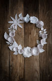 Paper flowers on the wood background. Paper flowers on wood background in the form of a circle Stock Images