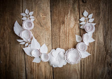 Paper flowers on the wood background. Paper flowers on wood background in the form of a semicircle Stock Photo