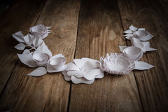 Paper flowers on the wood background. Paper flowers on wood background in the form of a semicircle Royalty Free Stock Photography