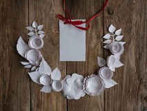 Paper flowers on the wood background. Paper flowers on wood background in the form of a semicircle and white card Royalty Free Stock Image