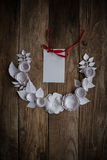 Paper flowers on the wood background. Paper flowers on wood background in the form of a semicircle and white card Royalty Free Stock Images