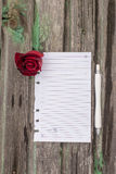Paper. Flowers and paper on wooden background Royalty Free Stock Photo