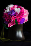 Paper flowers  in wooden vase Royalty Free Stock Image