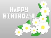 Paper. Flowers and the words happy birthday on a gray background Royalty Free Stock Images
