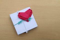 Paper fold shape heart on packing envelope Stock Image