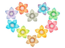 Paper folded flowers arranged in a heart shape. Isolated on a white background Royalty Free Stock Images