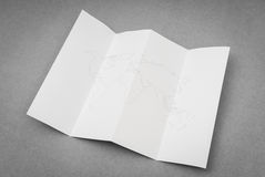 Paper folded with world map . Paper folded with world map royalty free stock image