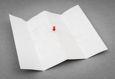 Paper folded world map with red Pin Pointer . Paper folded world map with red Pin Pointer royalty free stock photos