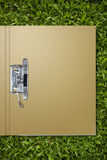Paper folder on grass Royalty Free Stock Photography