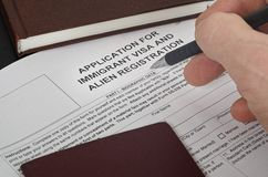 Paper Form US immigration visa lies on the black surface. On paper the form of immigration visas to visit the United States , is a fountain pen royalty free stock photos