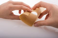 Paper forming a heart shape royalty free stock photo