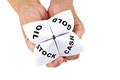 Paper Fortune Teller. Gold; Oil; Cash; Stock, concept of business decision Stock Photography