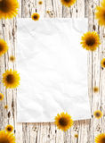 Paper frame. With old white wood background and sunflowers Stock Photo