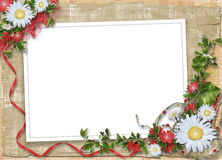 Paper frame with bouquet on the alienated backg Royalty Free Stock Photos