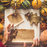Paper frame decorated with autumn leaves, pumpkins. Copy space Royalty Free Stock Photo