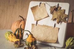 Paper frame decorated with autumn leaves, pumpkins Royalty Free Stock Photography