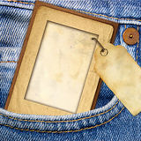 Paper frame and jeans Stock Image