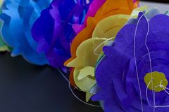Paper garland background. Colored paper garland over a black background Stock Photography