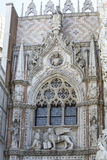 Paper gate in Venice. Marble statues of the winged lion (the symbol of Venice) and the doge Francesco Foscari above the Paper Gate (Porta della Carta) of the Royalty Free Stock Images