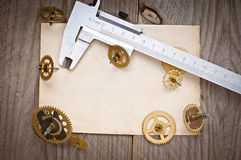 Paper and gears of the clock Stock Photography