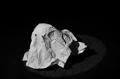 Paper Ghost. Photo light with bull's eye that portrays a piece of paper in the guise of a ghost Stock Image