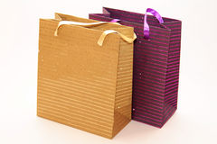 Paper gift bag. Purple and gold paper gift bag Royalty Free Stock Photo
