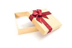 Paper gift box with deep red ribbon with a bow, on white Royalty Free Stock Image