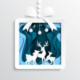 06.Paper gift box with deers on winter season background. Paper gift box with deers family joyful on blue snow and winter season background.For merry christmas Royalty Free Stock Photos