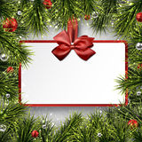Paper gift card on frame with spruce branches. Stock Image