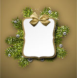 Paper gift card over spruce twigs Stock Photo