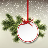Paper gift card on spruce branches. Royalty Free Stock Photography