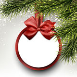 Paper gift card on spruce branches. Royalty Free Stock Images